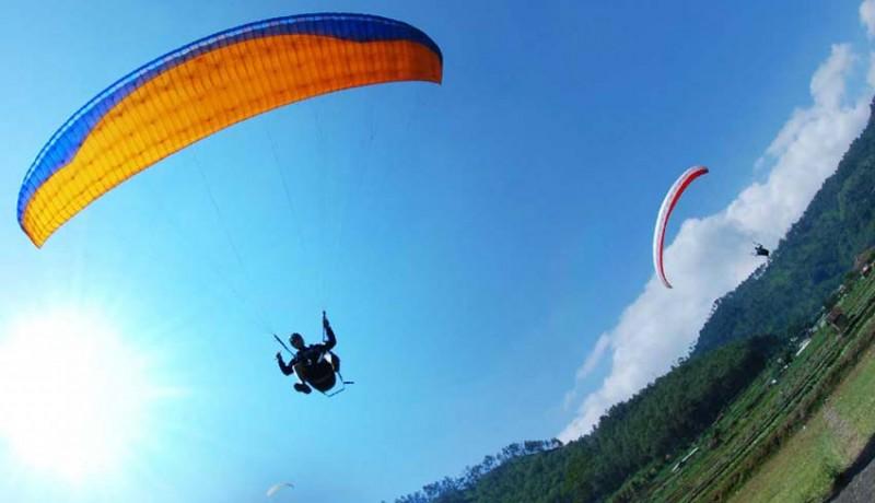Wisata Ekstrim dan Menegangkan, Ini Dia Spot Paralayang Seru di Bali